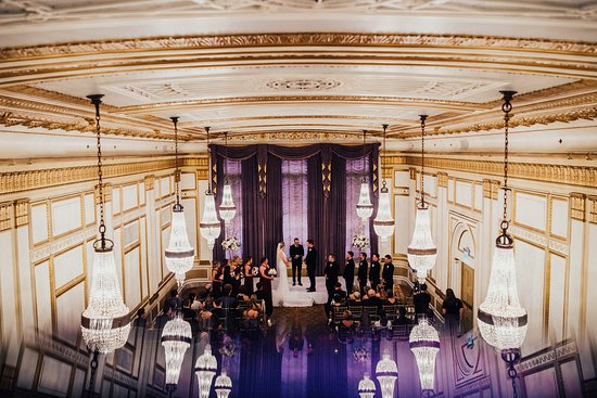 The historic and elegant Crystal Ballroom with its unique Austrian crystal chandeliers and cathedral windows is an exquisite space for a wedding ceremony.
