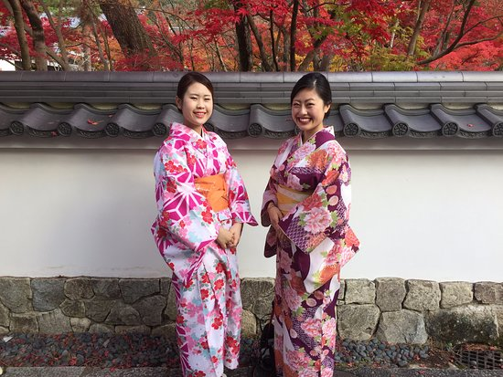 Japanese women dressed in a traditional floral Kimono in Higashiyama during autumn