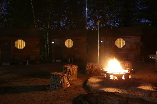 Campfire outside the cabins at night.