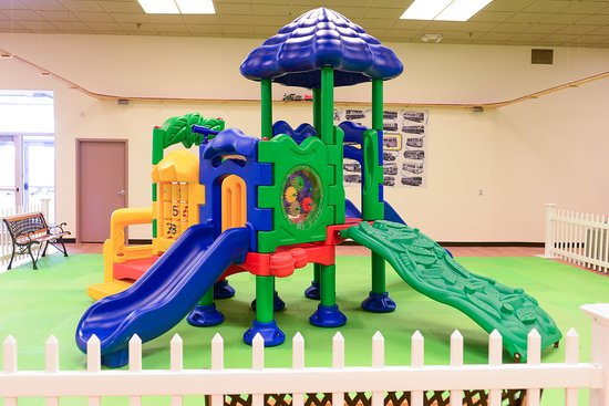 Burton, MI: Climb and slide in the family play area! Located inside Sloan Museum at Courtland Center.