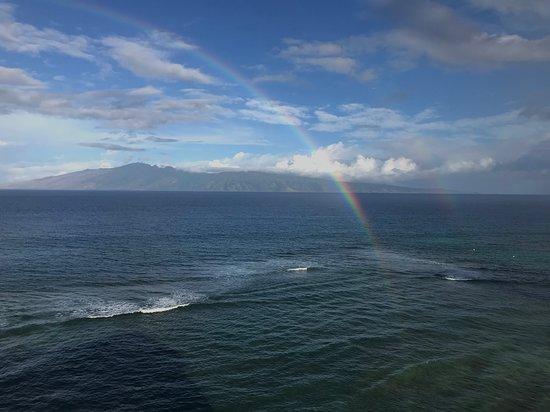 Island of Molokai and rainbow from Maui Kai condominiums Kaanapali Beach Maui - January 2019.