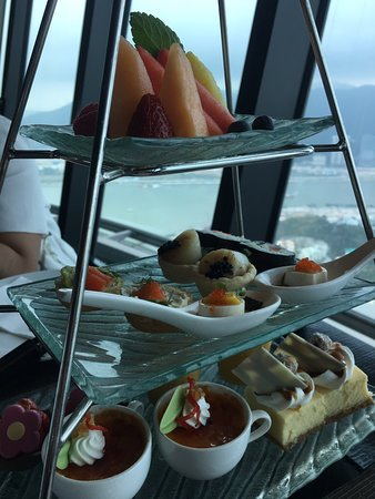 Luxurious afternoon tea with intermittent shows outside window