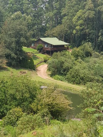 The Kingfisher cottage. Sleep 6-8. Electricity, spacious veranda and well equipped kitchen. Beautiful view on the dams and over the misty green hills.
