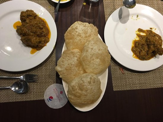Oh! Calcutta: Kosho murgi with Luchi