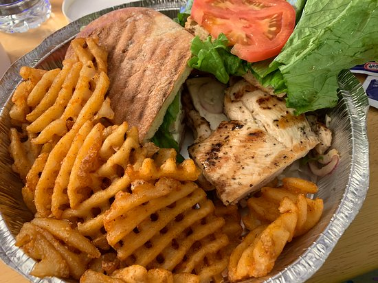 Carryout: Mediterranean Chicken Sandwich (grilled chicken, feta, cucumber, tomato, red onion, lettuce), ciabatta bread, tzatziki, waffle fries