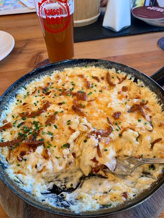 Herzhafte Käsespätzle - small dumplings in a savoury cheese sauce, a hearty Austrian/German traditional meal