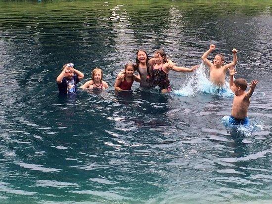 Weidman, MI: Kids Having fun in the Blue Pond.