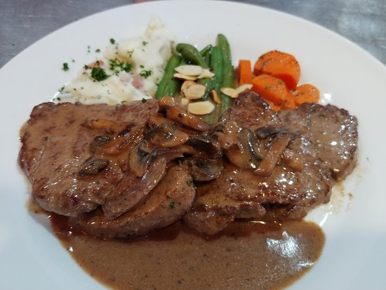 Elements Destination Restaurant: Beef Diane! Pan seared Beef Tenderloin with a Mushroom & Dijon Demi-Glace Sauce! YUM.