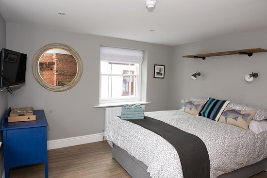 Room 3. A double bed with ensuite bath and shower. Views over the estuary.