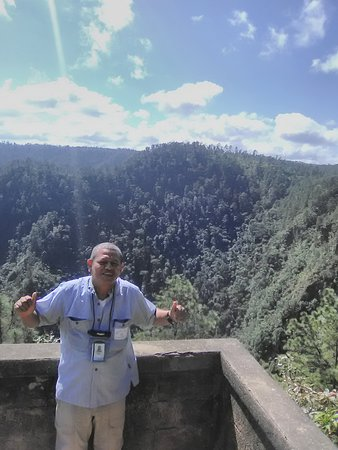 Posing at the balcony at 1000 ft falls, mountain Pine Ridge, Cayo District