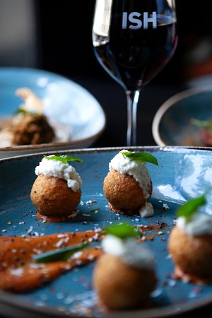 Sambar arancini with coconut and tomato chutney