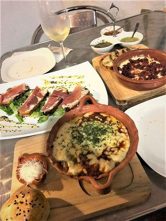 Starters top right, Gourmet House sauces, Choriqueso, Serrano ham.  Fresh Homemade Pasta, Lasagna!  Voilà
