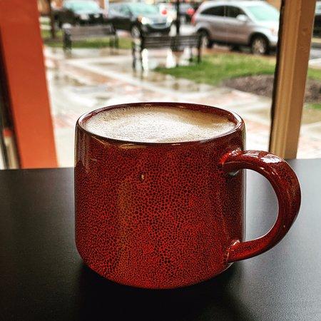 A latte in a nice ceramic mug.