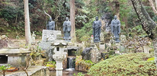 Various statues and waterfalls on the way up to the temple.