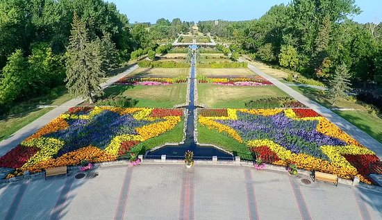 Dunseith, ND: Ariel view of the International Peace Garden hosting more than 80,000 annuals and perennials in the formal gardens. The center canal marks the international border between the U.S. and Canada.