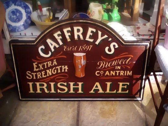 East Cowes, UK : Caffreys Wooden sign