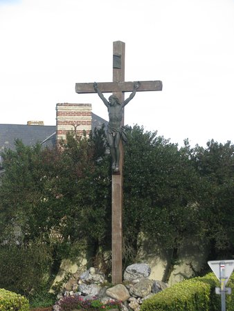 A cross at the entrance to the small village of Pennedepie Normande France