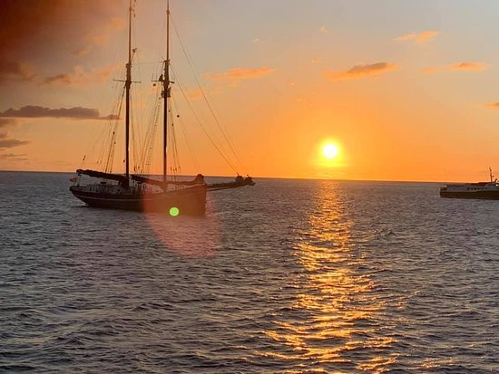 Nevis: Pic of Schooner with sun setting in the background..taken from the Tango Too on sunset cruise!