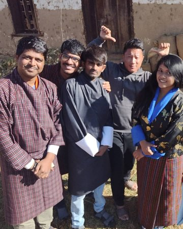 Wangdue Phodrang District, Bhutan: Trying the Bhutanese national dress in our farmhouse in Phobjikha