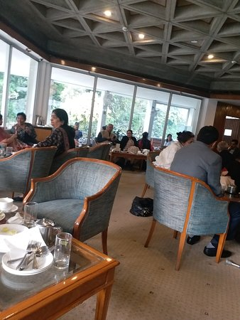 India International Centre: This is another picture of the ground floor lounge of the main building where visitors and members are enjoying lovely snacks with tea or coffee. Governor Amolak Rattan Kohli