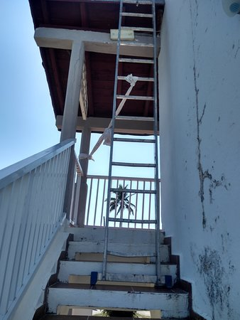 Had to squeeze by this ladder to go see 2nd room.