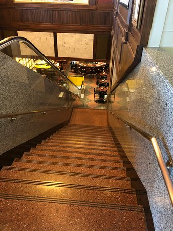 walking down.  escalator broken