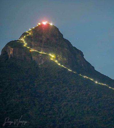 "Sabaragamuwa Province, ศรีลังกา: Adam's Peak is a 2,243 m (7,359 ft) tall conical mountain located in central Sri Lanka. It is well known for the Sri Pada, i.e., ""sacred footprint"", a 1.8 m (5 ft 11 in) rock formation near the summit, which in Buddhist tradition is held to be the footprint of the Buddha, in Hindu tradition that of Shiva and in Islamic and Christian tradition that of Adam, or that of St. Thomas"