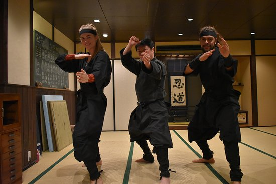 Posing as a ninja at Ninja Dojo and Store with one of our excellent instructors! Highly recommend :D