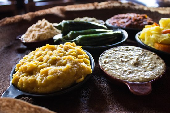Addis in Cape Ethiopian Restaurant: Cultural dining at its best. We strive to showcase Ethiopia's rich history and traditions in everything we do. Come eat some real food. Be served from a woven basket and eat with your hands while scooping up all these delicious flavours with Injera.