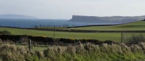 Causeway Coast & Glens, UK: View of Raithlin Island and Fair Head from the front of Woodleigh Cottage