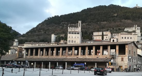 Building exterior with a panorama of Gubbio behind it