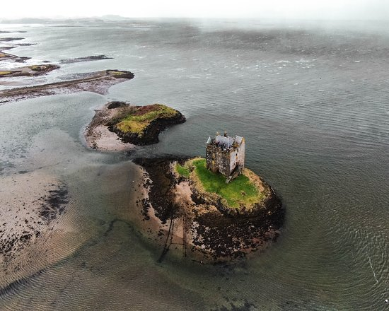 Appin, UK: Castle Stalker on the coast of Scotland. We've spent a week driving around Scotland shooting castles and coastlines and think this is my favorite yet.