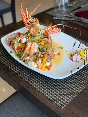 Caribbean Lobster stuffed with shrimps, conch, octopus and scallops