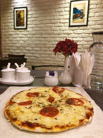 Sky Wok Ladakh : Thin crust Margarita Pizza