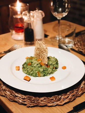 Our Vegan Butternut and Asparagus Risotto with a crushed pea sauce topped with Vegan parmesan crisps.