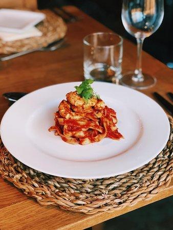 Our Tomato and garlic tagliatelle topped with smoked paprika king prawns.