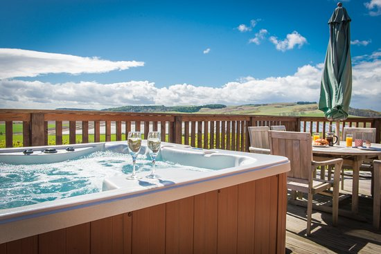 Barn Lodge at Balmeadowside Country Lodges & Cottages, near Cupar in Fife, sleeps 4 and offers some of the best views of the Fife countryside from the luxury of your own private hot tub