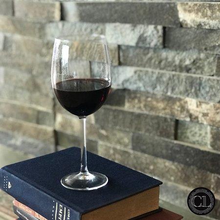 """Prueba nuestro vino tinto de la casa """"Entrelineas"""". * Try our red wine from the house """"Entrelineas""""."""