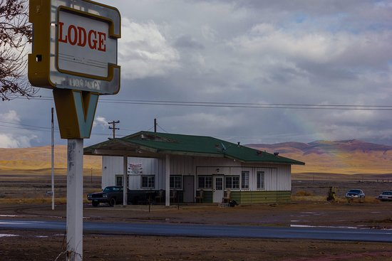California Valley Motel: A rainbow behind the former-auto service station and soon-to-be real estate office across the street from the Lodge. This is Dec 2018, it's looking better now than it did then.