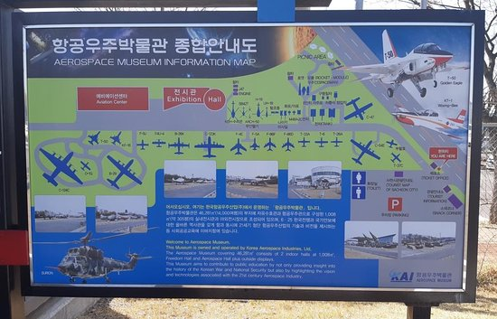 An overview poster of the planes & 2 exhibition buildings