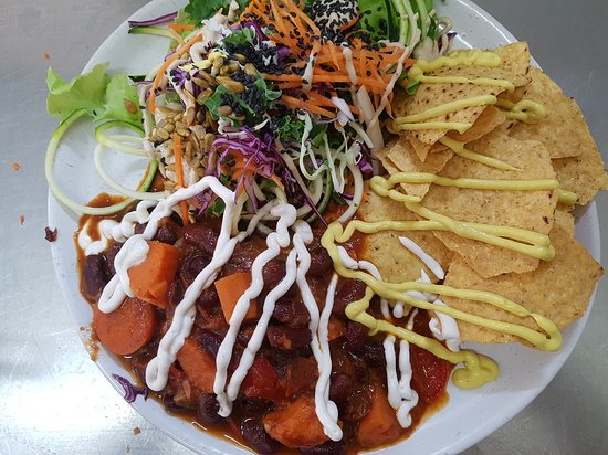Bean chilli with corn chips topped with cashew sour cream & cashew cheeze with a side salad of coleslaw drizzled in garlic tahini dressing.