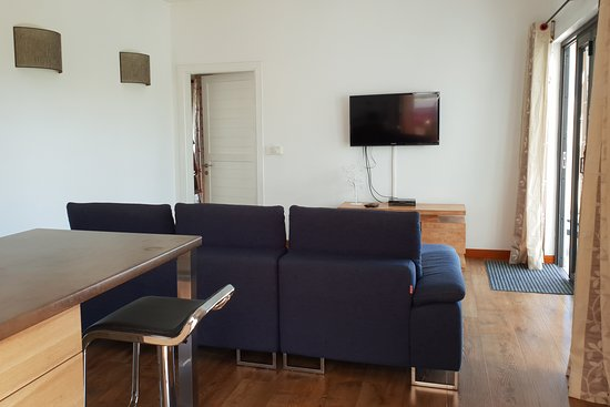 Pingo Premium Guest House: Lounge area from kitchen - door on left to bedroom on right to balcony.