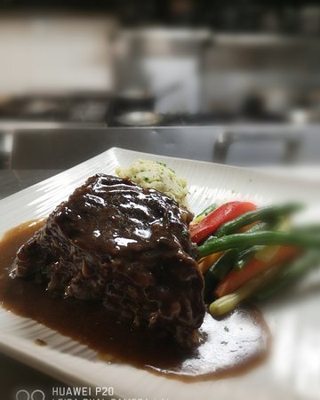 Dinner features with Braised Short Rib in red wine and herbs.