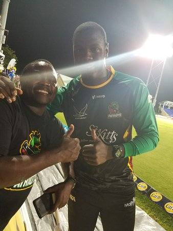 Chris Gayle, Captain of The St Kitts Nevis Patriots and Vibes General Manager Dominic Stevens pose for a picture after the big game.