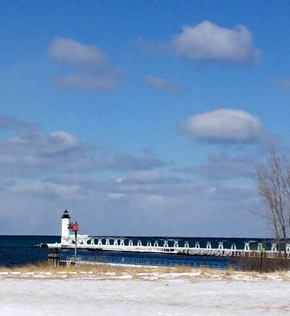 Manistee, MI: Winter photo taken from other side of the channel after being repainted. 2017