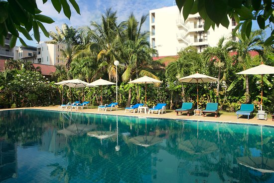 Swimming pool surrounded by lush and large garden area at Patong Palace Hotel