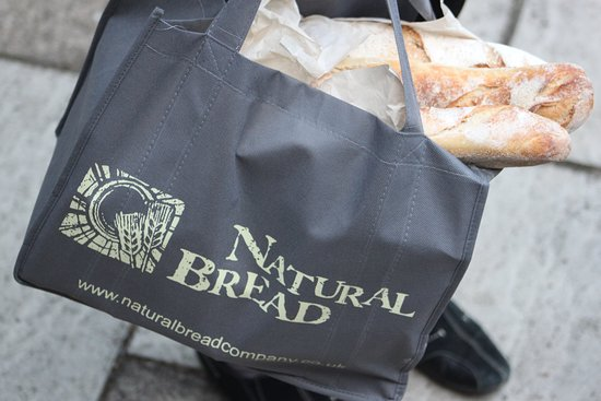 Natural Bread: Woven, logo shopping bags available for you to reuse over and over again