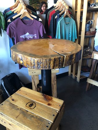 Clothing for sale. Tree stump tables.
