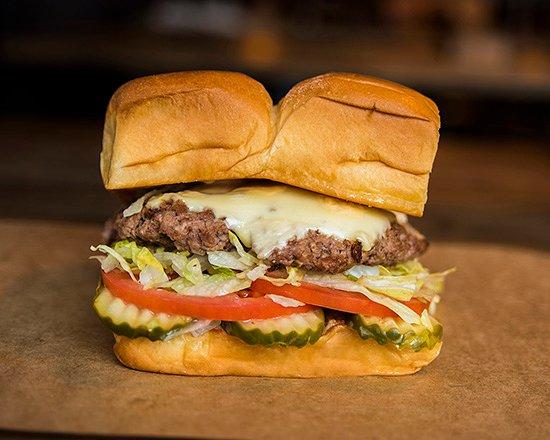 Dog Haus Biergarten Long Beach: CHEESEBURGER – white american cheese, pickles, lettuce, tomato, onion, secret sauce