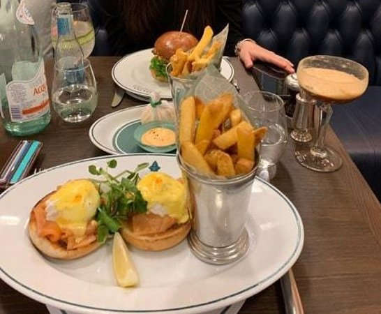 Eggs Royale (front) and shrimp & avocado burger (back)